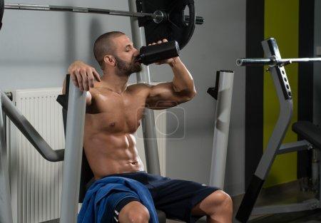 Bodybuilder Drinking Water From Shaker