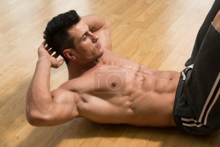 Male Doing Push-Ups In A Gym