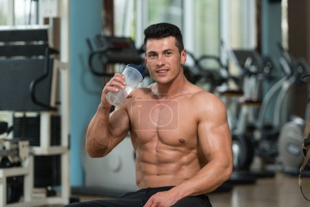 Body builder Drinking Water From Shaker