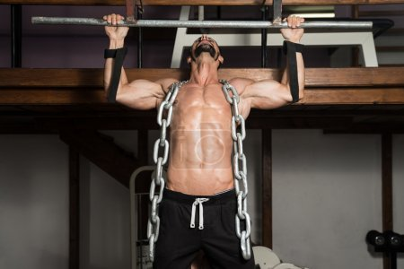 Man Doing Back Exercises With Chains