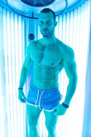 Young Man At Solarium In Beauty Salon