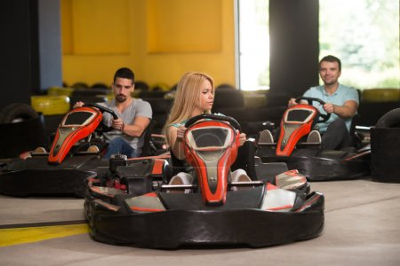 Group Of People Driving Go-Kart Karting Race