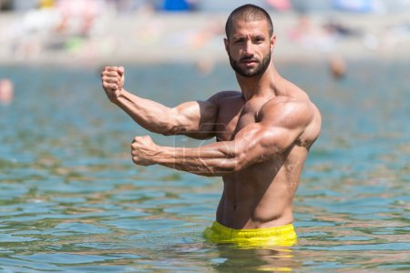 Biceps Pose In The Swimming Pool