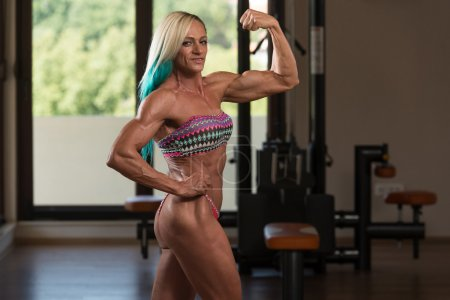 Middle Aged Woman Performing Rear Double Biceps Pose