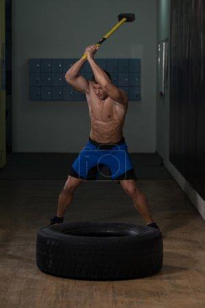 Athletic Man Hits Tire