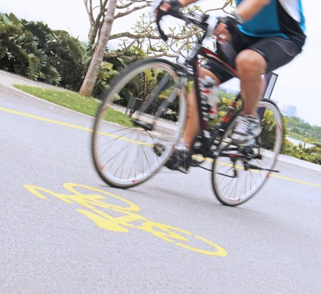 Man riding a bicycle in the park, selective Focus