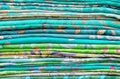 pile of colorful fabric .