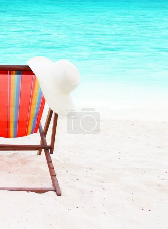 chair with a hat on the beach