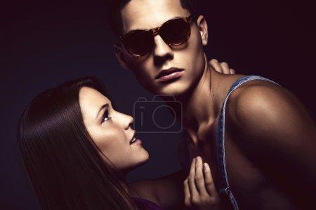 Fashion portrait of young beautiful couple