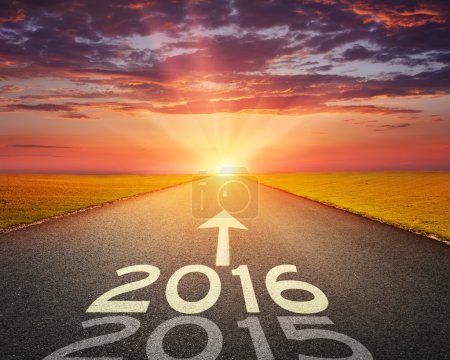 Empty road to upcoming 2016 at sunset
