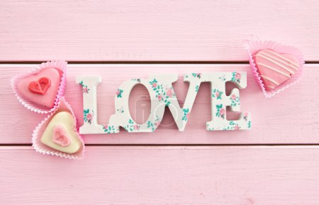 LOVE on pink wooden background