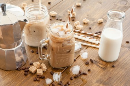 Photo for Iced coffee with milk in vintage jar - Royalty Free Image