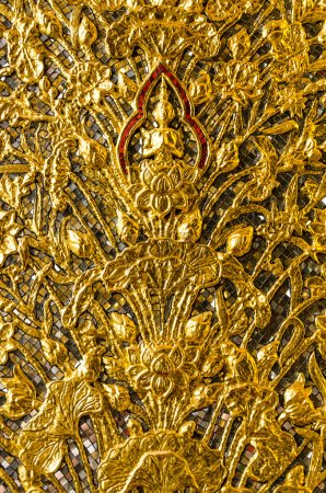 Photo for Golden Buddha sitting on a lotus pattern on ancient Thai temple wall - Royalty Free Image