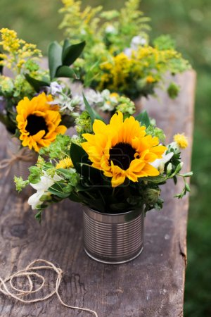 Photo for Wild flowers in a tin vase. - Royalty Free Image