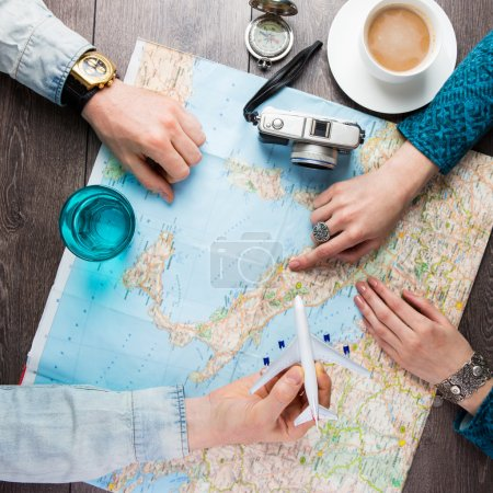 planning vacation trip with map