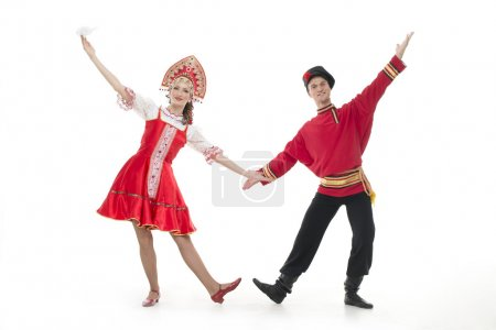 Photo for Dancing couple in russian national costumes hold hands - Royalty Free Image