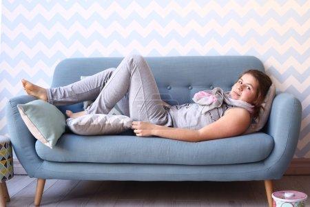 teenager girl lay on the sofa in pajama
