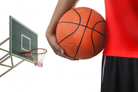 Close-up of basketball player with a ball