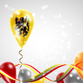 Flag of Flanders on balloon Celebration and gifts Ribbon in the colors of the flag are twisted under the balloon Independence Day Balloons on the feast of the national day