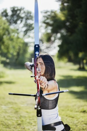 Photo for Front View Of Female Archer Training At The Range - Royalty Free Image