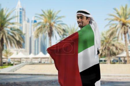 Male Holding Flag