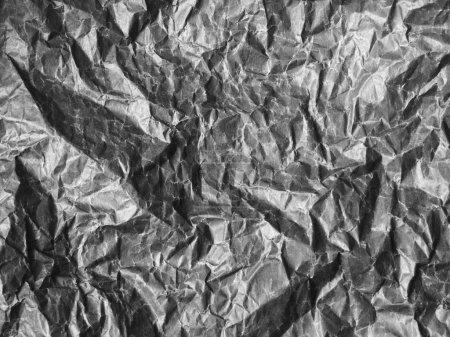 Photo pour Une feuille de papier froissée noire - image libre de droit