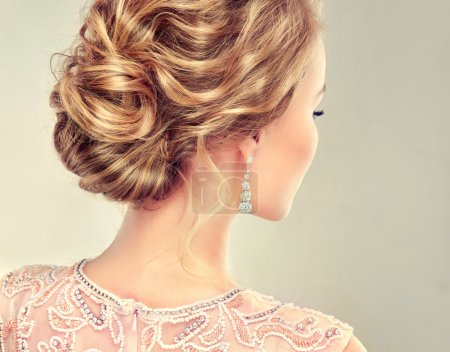 blonde woman with stylish hairdo