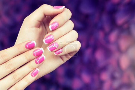 woman with pink nail polish