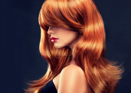 Girl with beautiful and shiny red hair