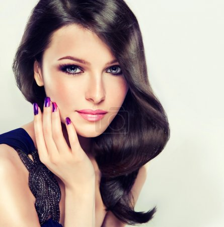 Photo pour Beautiful brunette girl with long hair , dress on one shoulder and purple nails - image libre de droit
