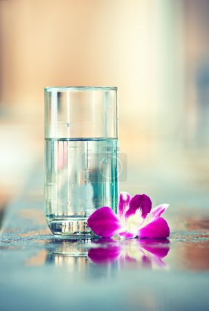 Flower with glass of clear water