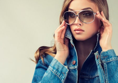 Photo for Fashion portrait of young beautiful woman with sunglasses - Royalty Free Image