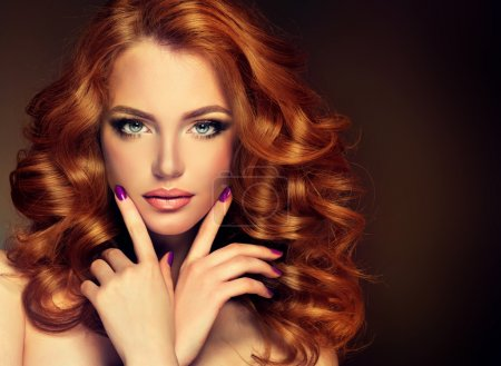 Woman with curled hair and perfect manicure
