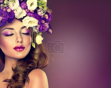 Photo for Beautiful young woman with long brown hair in floral wreath - Royalty Free Image