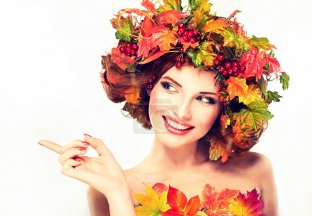 Girl with autumn wreath of leaves