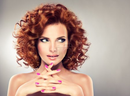 Photo for Beautiful young redhead woman with bright makeup and manicure - Royalty Free Image