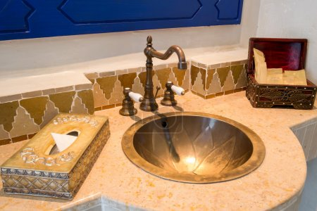 Photo for Moroccan Vintage Style Bathroom with Amenities - Royalty Free Image