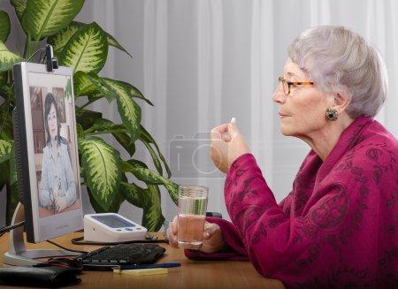 Taking pill during virtual medical practitioner visit