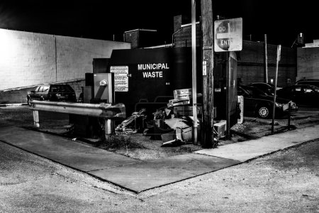 Dumpster in a parking lot at night in Hanover, Pennsylvania.