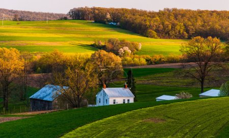 Home and barn on the farm fields and rolling hills of Southern Y
