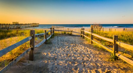 Path over sand dunes to the Atlantic Ocean at sunrise in Ventnor