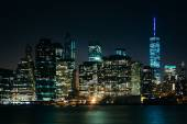 The Manhattan Skyline at night, seen from Brooklyn Bridge Park,