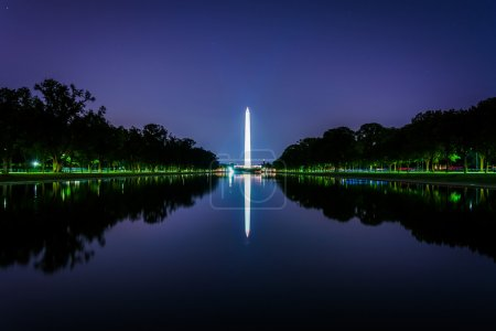 The Washington Monument reflecting in the Reflection Pool at nig