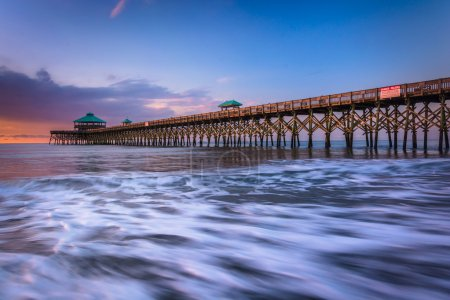 Photo for The fishing pier at sunrise, in Folly Beach, South Carolina. - Royalty Free Image