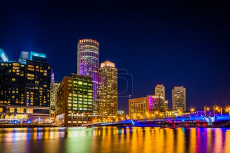 Photo for The Boston skyline at night, seen from Fort Point, Boston, Massachusetts. - Royalty Free Image