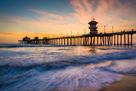 Waves in the Pacific Ocean and the pier at sunset, in Huntington