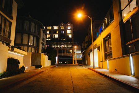 Modern buildings along a street at night, in Santa Monica, Calif