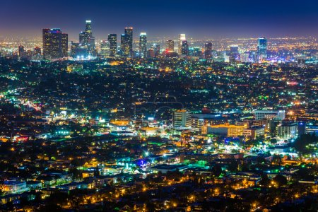 Photo for View of the downtown Los Angeles skyline at night, from Griffith Observatory, in Griffith Park, Los Angeles, California. - Royalty Free Image