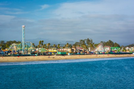 Photo for View of the rides on the Santa Cruz Boardwalk and the beach from the Wharf, in Santa Cruz, California. - Royalty Free Image