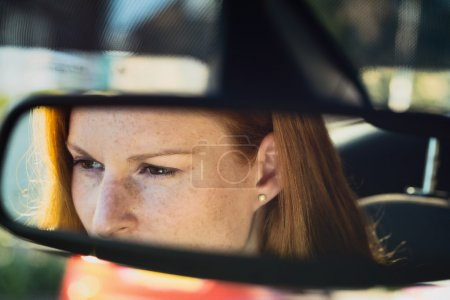 Woman Driving a Car - Reflection in the Mirror